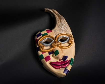 Jesters mask, red, green, and purple squares, gold and silver eyes and glitter