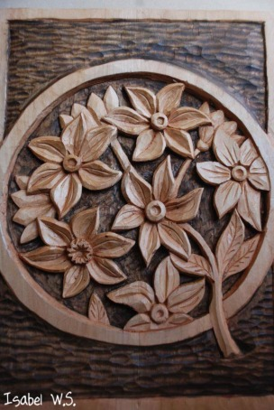 relief woodcarving, flowers in a circle, carpenter flowers