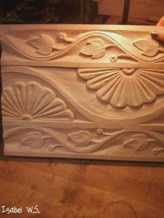 a door pattern woodcarving, sunbursts, vines with leafs and buds