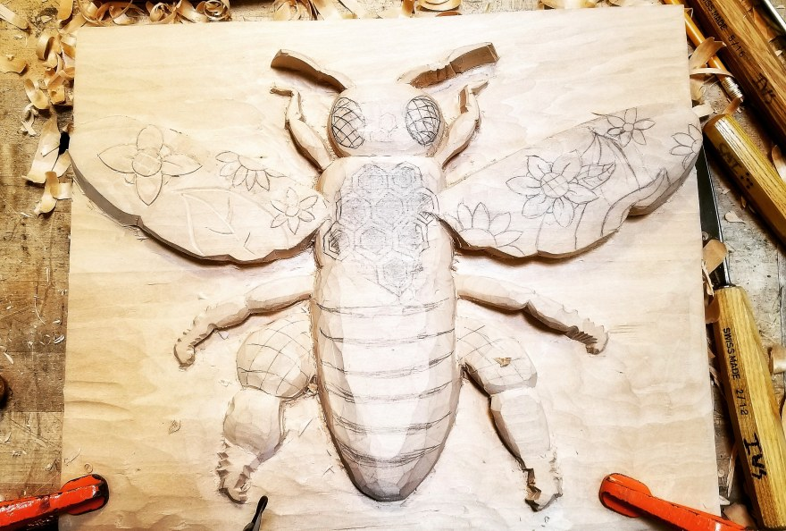 Unfinished bee woodcarving