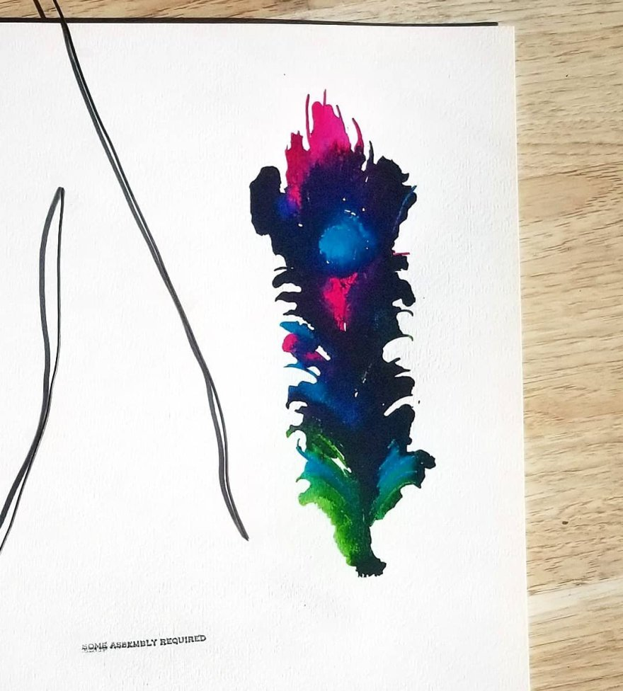 Collage of multicolored feather in inks, a stamp that says