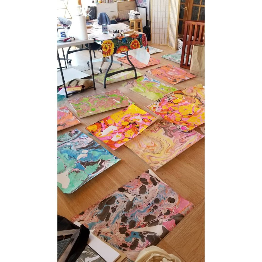 20 large marbled prints on a studio floor