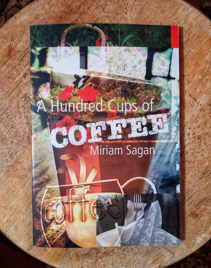 Cover art of a small press book by Miriam Sagan, collages coffee pots, signs, ripped books